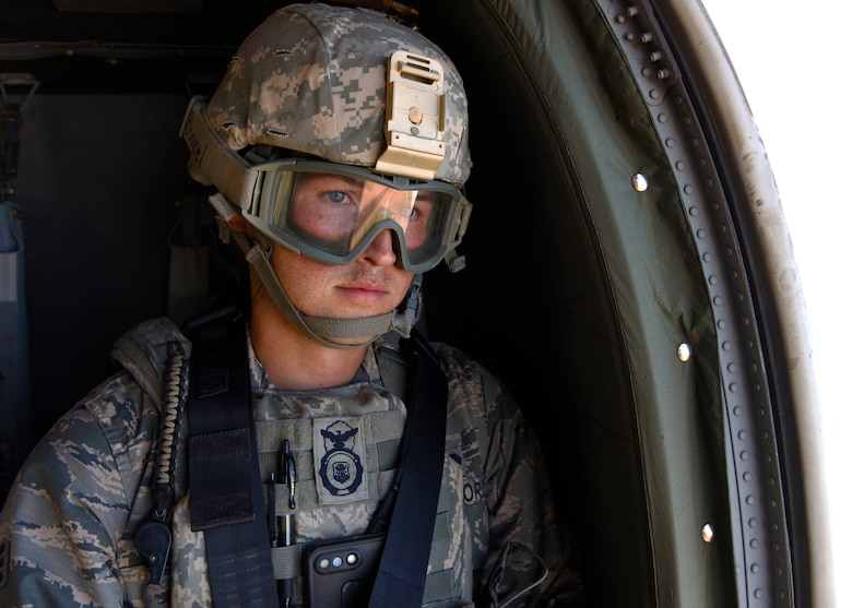 Senior Airman Zachory Boozel, 56th Security Forces Squadron military working dog handler, rides in a UH-60 Black Hawk during a joint training exercise at Glendale Municipal Airport Nov. 2, 2018, in Glendale, Ariz.