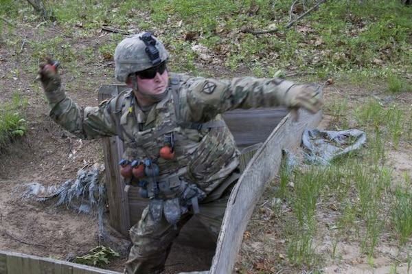 U.S. Army Spc. Andres Diaz, Detachment 1, Alpha Company, 572nd Brigade Engineer Battalion, 86th Infantry Brigade Combat Team (Mountain), Vermont National Guard, throws a training grenade at Fort Drum, N.Y., June 13, 2017.  The Vermont Guard is a finalist in the Army Communities of Excellence.