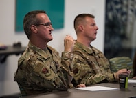 Maj. Gen. Peter Gersten, U.S. Air Force Warfare Center commander, and Chief Master Sgt. Charles Hoffman, USAFWC command chief, listen to an idea presentation Oct. 29, 2018, at AFWERX-Vegas. Gersten and Hoffman listened to seven presentations before selecting two to advance to present at the Air Combat Command competition. (U.S. Air Force photo by Airman 1st Class Andrew D. Sarver)
