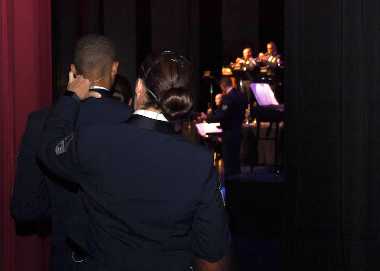 Master Sgt. Rebecca Wischmann, vocalist with the U.S. Air Force Heartland of America Band, adjusts Airman 1st Class Mario Foreman-Powell's collar, a fellow vocalist in the band, prior to heading onstage for a concert November 6, 2018, at the Chester Fritz Auditorium in Grand Forks, North Dakota. The Heartland of America Band held a special Veterans Day performance to commemorate and celebrate all service members, past and present. (U.S. Air Force photo by Airman 1st Class Elora J. Martinez)
