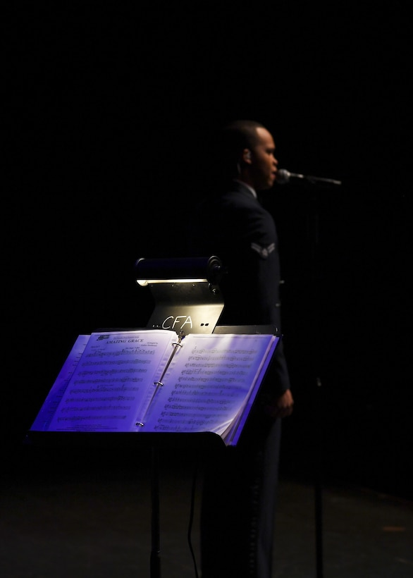 Airman 1st Class Mario Foreman-Powell, U.S. Air Force Heartland of America Band vocalist, sings for a crowd of about 700 people during a special Veterans Day concert honoring veterans and military service members November 6, 2018, at the Chester Fritz Auditorium in Grand Forks, North Dakota. Comprised of nine musicians and three vocalists, the band travels the country performing in a wide variety of venues to demonstrate Air Force excellence and precision. (U.S. Air Force photo by Airman 1st Class Elora J. Martinez)
