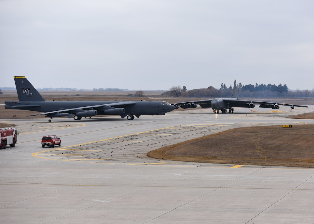 Two B-52H Stratofortresses pass each other on the flightline during Global Thunder 19 at Minot Air Force Base, N.D., Nov. 4, 2018. U.S. Strategic Command headquarters staff, components, and subordinate units participate in Global Thunder to test readiness and ensure a safe, secure, ready and reliable strategic deterrent force. Large-scale exercises of this nature involve extensive planning and coordination and provide unique training for assigned units and allies so they are ready and prepared to execute orders globally wherever and whenever needed. (U.S. Air Force Photo by Airman 1st Class Dillon J. Audit)