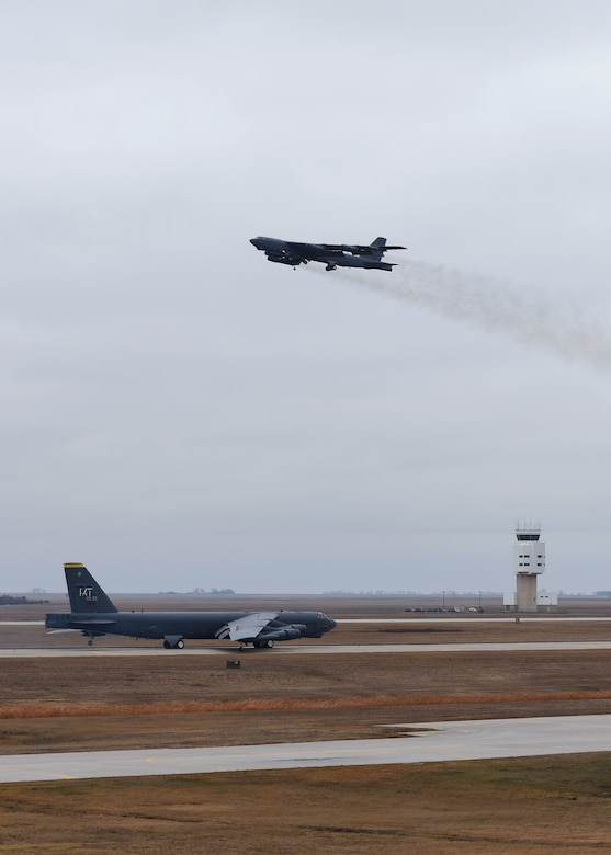 Two B-52H Stratofortresses pass each other during Global Thunder 19 at Minot Air Force Base, N.D., Nov. 4, 2018. Global Thunder is an annual U.S. Strategic Command (USSTRATCOM) exercise designed to provide training opportunities to test and validate command, control and operational procedures. The training is based on a notional scenario developed to drive execution of USSTRATCOM and component forces'; ability to support the geographic combatant commands, deter adversaries and, if necessary, employ forces as directed by the President of the United States. (U.S. Air Force Photo by Airman 1st Class Dillon J. Audit)