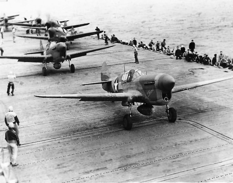 U.S. Army Air Forces P-40F Warhawk fighter aircraft prepare to launch from the deck of the USS Chernago off Morocco in support of Operation Torch, the Allied invasion of North Africa, on Nov. 8, 1942. Flight surgeon Lt. Samuel T. Moore treated Soldiers throughout the North Africa campaign, and kept a diary of his experiences. (Photo courtesy of U.S. Navy)