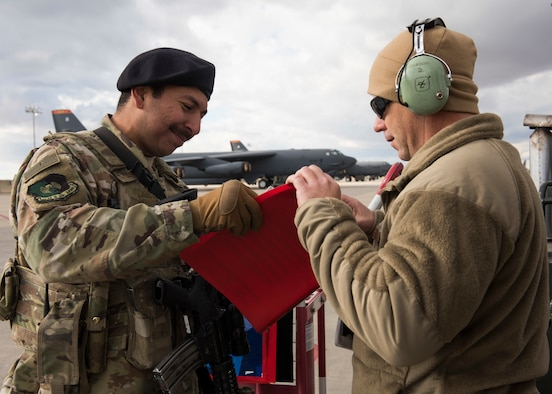 Airman 1st Class Bryan Blancas, 5th Security Forces Squadron defender, checks a flightline access badge during Global Thunder 2019 at Minot Air Force Base, North Dakota, Oct. 30, 2018. Global Thunder is an annual U.S. Strategic Command (USSTRATCOM) exercise designed to provide training opportunities to test and validate command, control and operational procedures. The training is based on a notional scenario developed to drive execution of USSTRATCOM and component forces' ability to support the geographic combatant commands, deter adversaries and, if necessary, employ forces as directed by the President of the United States. (U.S. Air Force photo by Senior Airman Alyssa M. Akers)