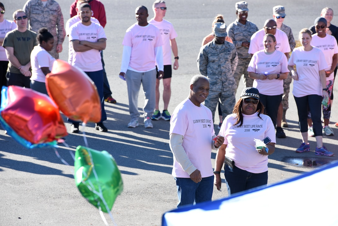 "Members of the North Carolina Air National Guard come together during a 1-mile walk/run to support family and friends of recently deceased U.S. Air Force Recruiter Master Sgt. Valanda Pettis. Master Sgt. Pettis' battle with cancer came to an end this Fall and to honor her memory, the NCANG Recruiting office hosted the Color Run, which involves a 1-mile walk/run with colorful chalk thrown in the air and on participants, to inspire cheer in those she left behind. The theme of the race, ""Livin' my best life,"" is a phrase Pettis was often heard singing or using around her loved ones to instill faith, joy, and love."