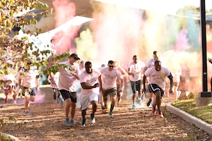 Members of the 145th Airlift Wing, family, and friends take off in a sprint during a 'Living' My Best Life' Color Race, held at the North Carolina Air National Guard (NCANG) Base, Charlotte Douglas International Airport, Nov. 3, 2018. The Color Run, put together by the NCANG Recruiting Office, honors recently deceased U.S. Air Force Recruiter Master Sgt. Valanda Pettis, following her battle with cancer. Master Sgt. Pettis was believed by many to have a colorful personality and would often be heard singing, 'Livin' My Best Life,' during the good and bad days; a true testament to her strength.