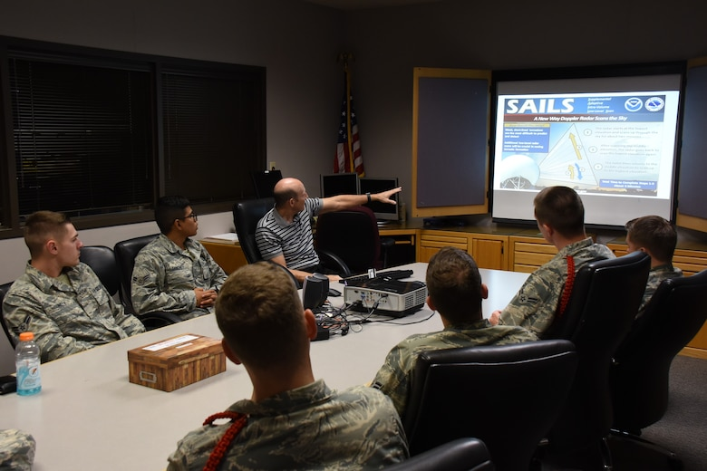 National Weather Service Meteorologist in Charge, Steve Lyons discusses the science behind their Doppler radar with 312th Training Squadron students at the NWS building in San Angelo, Texas, Nov. 7, 2018. The 312th TRS special instruments training students curriculum shares similarities with that of the NWS, due to their use of radar signals and the interpretation of those signals. (U.S. Air Force photo by Airman 1st Class Zachary Chapman/Released)