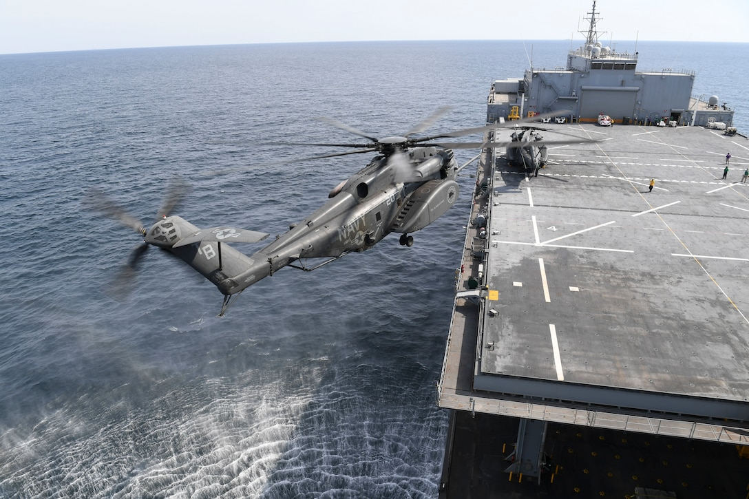 An MH-53E Sea Dragon, from Helicopter Mine Countermeasures Squadron (HM) 15, prepare to land on expeditionary mobile base platform ship USS Lewis B. Puller (ESB 3). Puller is deployed to the U.S. 5th Fleet area of operations in support of naval operations to ensure maritime stability and security in the Central Region, connecting the Mediterranean and the Pacific through the western Indian Ocean and three strategic choke points. (U.S. Navy photo by Mass Communication Specialist 2nd Class Kevin J. Steinberg/Released)
