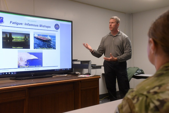 Kirk Clark, 341st Medical Operations Squadron health promotion coordinator, briefs Airmen Nov. 7, 2018, at Malmstrom Air Force Base, Mont.