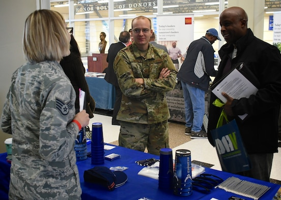 """Both recruiters Staff Sgt. Jennifer Deimund and Tech. Sgt. Michael Smith represented the 932nd Airlift Wing Recruiting Squadron at a recent outreach and job fair held Nov. 8, 2018, in Saint Louis, Missouri. They were on hand to talk to current and former military members and those non prior civilians interested in joining the Air Force Reserve Command for the first time.  For current reservists wanting to assist, the """"Get One Now"""" program is set up where current members help bring in new recruits and receive special reward items. To share the adventure and win a prize, current members should go to the webpage: www.Get1Now.us and new potential enlistees can call toll free at 1-800-257-1212 for more information about the Air Force Reserve. Senior Master Sgt. Melissa Melichar, who is the 932nd Recruiting Squadron Flight Chief in charge of all accessioning.  (U.S. Air Force photo by Lt. Col. Stan Paregien)"""