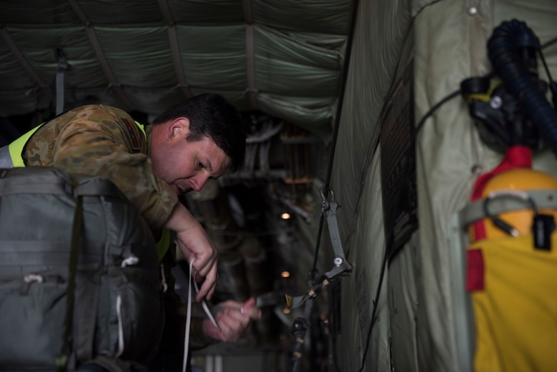 Image of WO2 Hawkins, Australian Army air dispatcher, straps down cargo on a C-130J Super Hercules before a flight Nov. 1, 2018, at Mountain Home Air Force Base, Idaho. One reason members of the Royal Australian Air Force chose to come to Mountain Home AFB is to perform pilot training in extremities against simulated threats to receive various qualifications. (U.S. Air Force photo by Senior Airman Alaysia Berry)