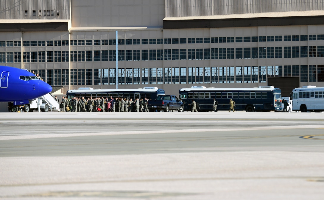 More than 100 Airmen from the 37th Bomb Squadron and 28th Aircraft Maintenance Squadron at Ellsworth Air Force Base, S.D., board a plane at Ellsworth Air Force Base, S.D., Oct. 25, 2018. The Airmen flew to Nevada to participate in exercise Green Flag. Green Flag is an air-to-surface training exercise in various parts of Nevada and California.