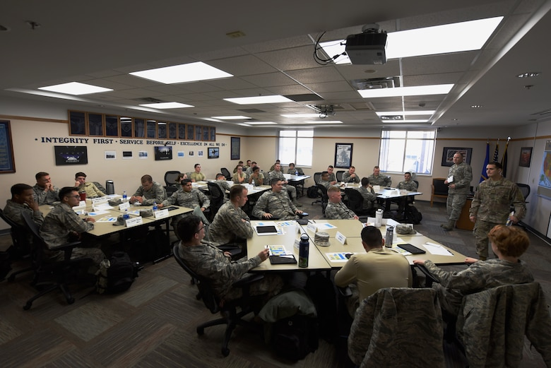 First-term Airmen participate in a group discussion during the First Term Airmen Course at the Rushmore Center on Ellsworth Air Force Base, S.D., Oct. 22, 2018. The FTAC course is a mandatory, weeklong program that is packed with professional development guidance, life-skills briefings and visits from base agencies to aid new Airmen with getting their careers started. (U.S. Air Force photo by Airman 1st Class Christina Bennett)