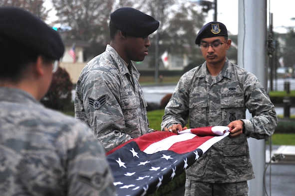 A flag detail from the 374th Security Forces Squadron folds the flag during a Veterans Day ceremony at Yokota Air Base, Japan, Nov. 9, 2018.