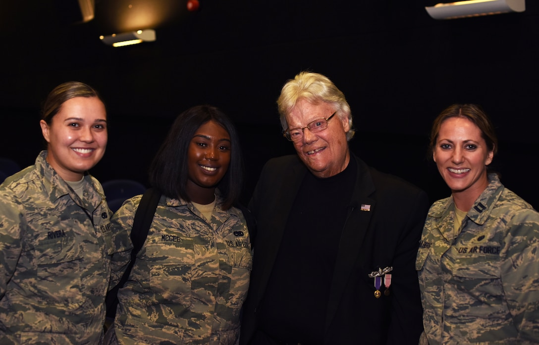 Dave Roever, Vietnam War veteran and Purple Heart recipient, poses for a photo with Team Mildenhall Airmen during a visit at RAF Mildenhall, England, Nov. 6, 2018. Roever presented a message of integrated resiliency and suicide prevention to Team Mildenhall Airmen. (U.S. Air Force photo by Airman 1st Class Brandon Esau)