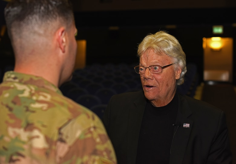 Dave Roever, Vietnam War veteran and Purple Heart recipient, speaks with U.S. Air Force Tech. Sgt. Marcelo Sierra, 100th Air Refueling Wing executive assistant to the command chief, during a visit at RAF Mildenhall, England, Nov. 6, 2018. Roever has taken his message of integrated resiliency and suicide prevention to troops around the globe. (U.S. Air Force photo by Airman 1st Class Brandon Esau)