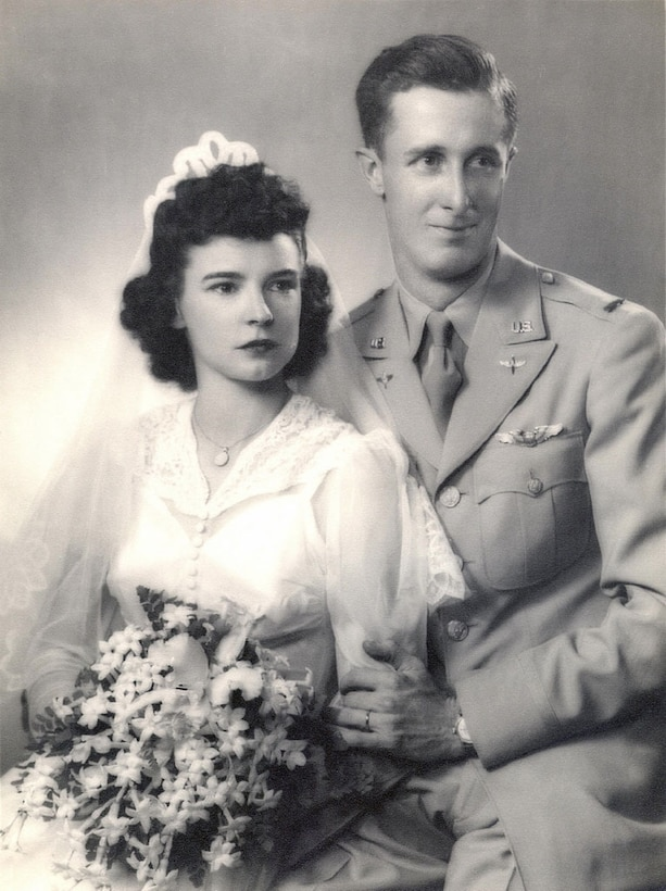 U.S. Army Air Corps 1st Lt. John D. Crouchley and his wife Dorothy, pose for their wedding photo in 1943. Crouchley was assigned to the 828th Bombardment Squadron, 485th Bombardment Group, Foggia, Italy, and went into combat in May 1944. His aircraft was shot down over Bulgaria June 28, 1944, when he and his crew were returning from a bombing mission over Romania. He was missing in action for 73 years until his partial remains were discovered by a team from the Defense POW/MIA Accounting Agency in 2017 and positively identified in September 2018. Crouchley's wedding ring, visible in the photo and engraved with his wife's initials, was one of the personal items found that was used to identify him. (Courtesy photo)