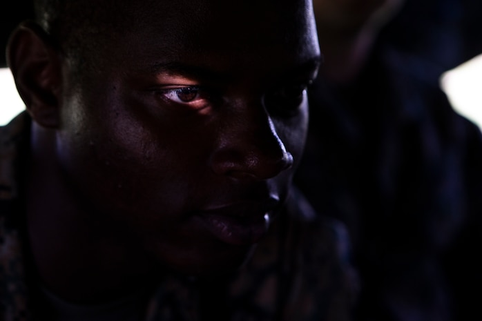 Lance Cpl. Tyreek Baxter, a 19-year-old water purification specialist from the Bronx, sits in the rear of a 7-ton flatbed truck while delivering U.S. Federal Emergency Management-provided shelter tents as part of U.S. Defense Support of Civil Authorities relief efforts on Tinian, Commonwealth of the Northern Mariana Islands, Nov. 9, 2018. Baxter enlisted in July 2017 after graduating from Harry S. Truman High School in June of the same year. Marines and Sailors with the 31st Marine Expeditionary Unit and CLB-31 are assisting local and civil authorities on Tinian to deliver FEMA shelters for families affected by Super Typhoon Yutu, which struck here Oct. 25 as the second strongest storm to ever hit U.S. soil. Marines and Sailors with the 31st MEU and CLB-31 arrived on Tinian Oct. 29-31 to lead relief efforts on Tinian in response to Yutu as part of Task Force-West. TF-W is leading the Department of Defense's efforts to assist CNMI's local and civil authorities provide critical assistance for citizens devastated by Yutu. The 31st MEU, the Marine Corps' only continuously forward-deployed MEU, provides a flexible force ready to perform a wide-range of military operations across the Indo-Pacific region.