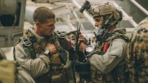 Marines with the Maritime Raid Force, 11th Marine Expeditionary Unit, complete gear checks for a night high-altitude high-opening parachute operation during Realistic Urban Training Exercise at Marine Corps Air Station Yuma, Ariz., Nov. 6, 2018. RUT is the final shore based exercise the 11th MEU will complete during their pre-deployment training cycle in preparation for deployment next year.
