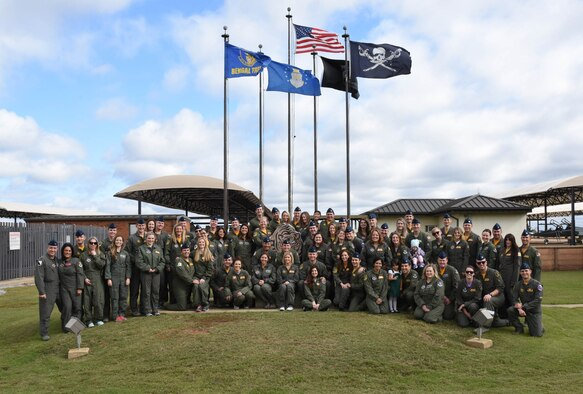 Many 37th Flying Training Squadron instructor pilots stand with their spouses Nov. 2, 2018, on Columbus Air Force Base, Mississippi. Spouse flights are annual for the 14th Operations group to thank spouses. Military spouses are next to uniformed members across the world, supporting the Air Force mission by supporting their Airmen. (U.S. Air Force photo by Elizabeth Owens)