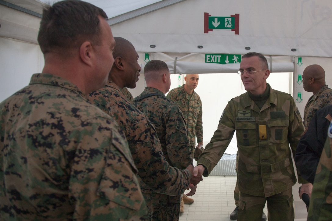 Norwegian Army Brig. Gen. Jon Morten Mangersnes, right, the commander of the Norwegian Land Warfare Center, shakes the hands of Marines with 2nd Marine Logistics Group-Forward (2nd MLG-Fwd), in Stjødal, Norway, Nov. 5, 2018. Leaders of the Norwegian military met with leaders and noncommissioned officers (NCOs) of 2nd MLG-Fwd to discuss the role of the Marine Corps NCO during Exercise Trident Juncture 18. The exercise enhances the U.S. and NATO Allies' and partners' abilities to work together collectively to conduct military operations under challenging conditions. (U.S. Marine Corps photo by Lance Cpl. Scott R. Jenkins)