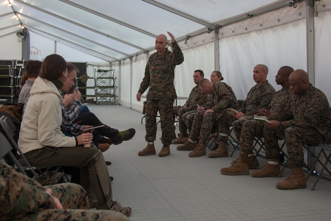 U.S. Marine Corps Sgt. Maj. Alex Narvaez, the sergeant major. of 2nd Marine Logistics Group-Forward (2nd MLG-Fwd), speaks to Norwegian military leaders in Stjødal, Norway, Nov. 5, 2018. Leaders of the Norwegian military met with leaders and noncommissioned officers (NCOs) of 2nd MLG-Fwd to discuss the role of the Marine Corps NCO during Exercise Trident Juncture 18. The exercise enhances the U.S. and NATO Allies' and partners' abilities to work together collectively to conduct military operations under challenging conditions. (U.S. Marine Corps photo by Lance Cpl. Scott R. Jenkins)