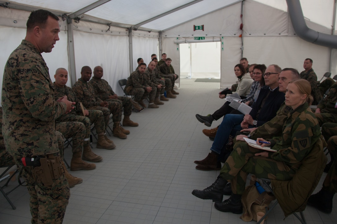 U.S. Marine Corps Master Gunnery Sgt. Dale Hardwood, with 2nd Marine Logistics Group-Forward (2nd MLG-Fwd), speaks to Norwegian military leaders in Stjørdal, Norway, Nov. 5, 2018. Leaders of the Norwegian military met with leaders and noncommissioned officers (NCOs) of 2nd MLG-Fwd to discuss the role of the Marine Corps NCO during Exercise Trident Juncture 18. The exercise enhances the U.S. and NATO Allies' and partners' abilities to work together collectively to conduct military operations under challenging conditions. (U.S. Marine Corps photo by Lance Cpl. Scott R. Jenkins)