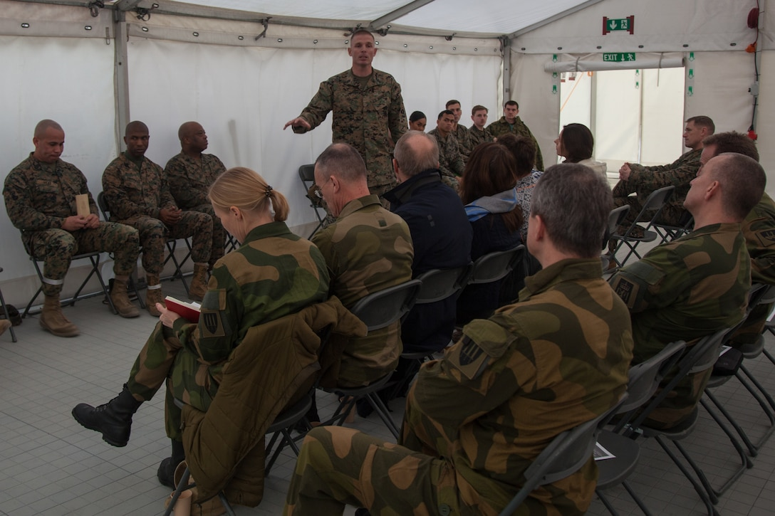 U.S. Marine Corps 1st Sgt. Johnny Huff, with 2nd Marine Logistics Group-Forward 2nd (MLG-Fwd), speaks to Norwegian military leaders in Stjødal, Norway, Nov. 5, 2018. Leaders of the Norwegian military met with leaders and noncommissioned officers (NCOs) of 2nd MLG-Fwd to discuss the role of the Marine Corps NCO during Exercise Trident Juncture 18. The exercise enhances the U.S. and NATO Allies' and partners' abilities to work together collectively to conduct military operations under challenging conditions. (U.S. Marine Corps photo by Lance Cpl. Scott R. Jenkins)