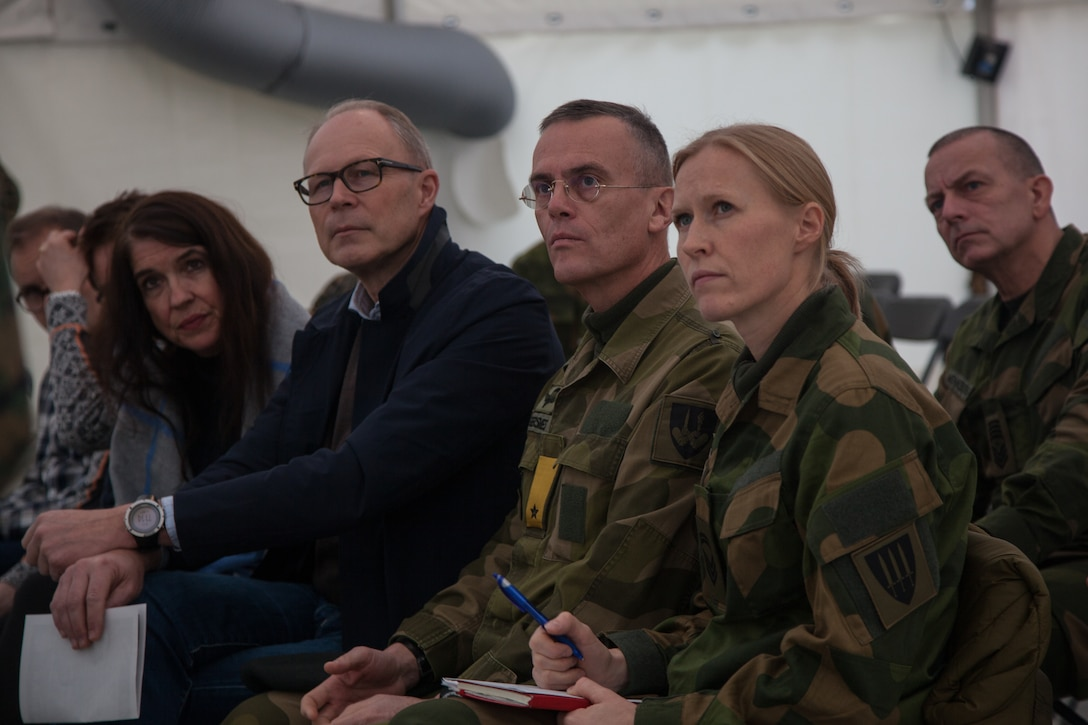 Norwegian military leaders listen to U.S. Marine speakers during a presentation in Stjødal, Norway, Nov. 5, 2018. Leaders of the Norwegian military met with leaders and noncommissioned officers (NCOs) of 2nd MLG-Fwd to discuss the role of the Marine Corps NCO during Exercise Trident Juncture 18. The exercise enhances the U.S. and NATO Allies' and partners' abilities to work together collectively to conduct military operations under challenging conditions. (U.S. Marine Corps photo by Lance Cpl. Scott R. Jenkins)