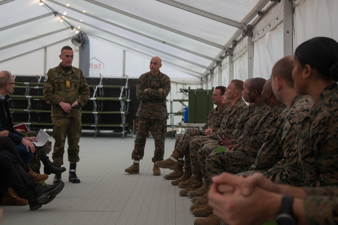 Norwegian Army Brig. Gen. Jon Morten Mangersens, right, the commander of the Norwegian Land Warfare Center, speaks with U.S. Marines from 2nd Marine Logistics Group-Forward (2nd MLG-Fwd) in Stjødal, Norway, Nov. 5, 2018. Leaders of the Norwegian military met with leaders and noncommissioned officers (NCOs) of 2nd MLG-Fwd to discuss the role of the Marine Corps NCO during Exercise Trident Juncture 18. The exercise enhances the U.S. and NATO Allies' and partners' abilities to work together collectively to conduct military operations under challenging conditions. (U.S. Marine Corps photo by Lance Cpl. Scott R. Jenkins)