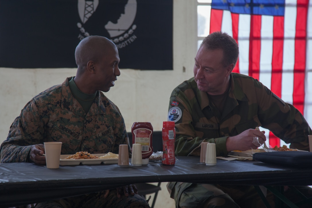 U.S. Marine Corps 1st Sgt. Nicholas Underwood, the acting sergeant major of Combat Logistics Battalion 251, 2nd Marine Logistics Group-Forward (2nd MLG-Fwd), speaks with Lt. Col. Ruwk Larsen, with the Norwegian Army Land Warfare Center, in Stjødal, Norway, Nov. 5, 2018. Leaders of the Norwegian military met with leaders and noncommissioned officers (NCOs) of 2nd MLG-Fwd to discuss the role of the Marine Corps NCO during Exercise Trident Juncture 18. The exercise enhances the U.S. and NATO Allies' and partners' abilities to work together collectively to conduct military operations under challenging conditions. (U.S. Marine Corps photo by Lance Cpl. Scott R. Jenkins)