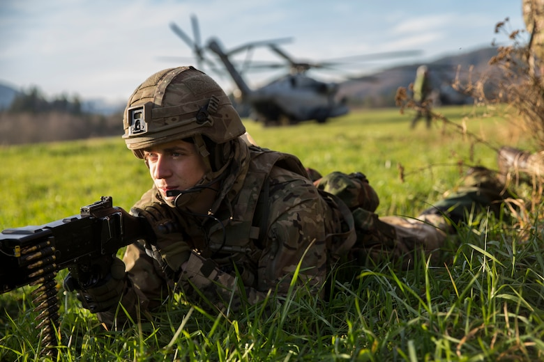 A British Royal Marine provides security after disembarking a U.S. Marine Corps CH-53E Super Stallion during a Tactical Recovery of Aircraft and Personnel (TRAP) exercise in Rindal, Norway, Nov. 6, 2018. The Royal Marines with X-Ray Company, 45 Commando, worked in conjunction with the 24th Marine Expeditionary Unit and assets from Marine Aircraft Group 29 to increase their TRAP proficiency and bilateral interoperability during Exercise Trident Juncture 18. The exercise enhances the U.S. and NATO Allies' and partners' abilities to work together collectively to conduct military operations under challenging conditions. (U.S. Marine Corps photo by Cpl. Margaret Gale)