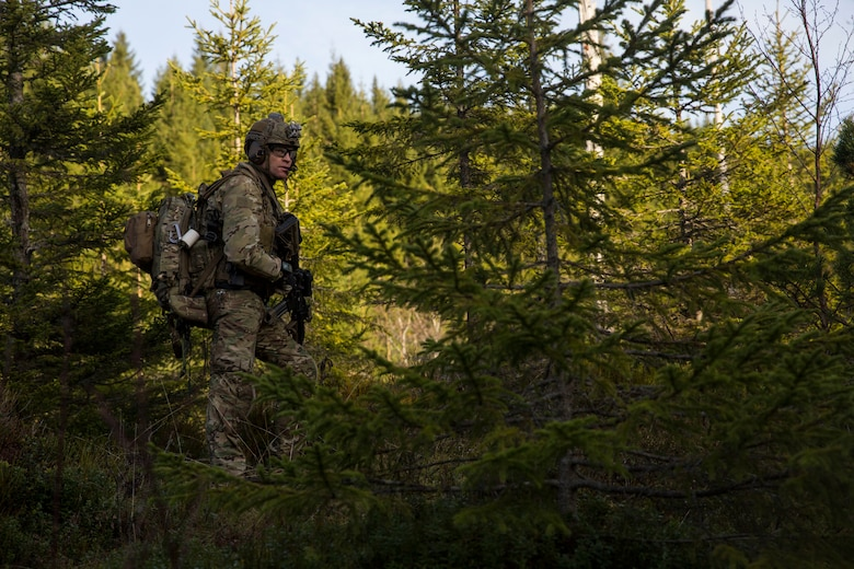 A British Royal Marine searches for a simulated isolated service member during a Tactical Recovery of Aircraft and Personnel (TRAP) exercise in Rindal, Norway, Nov. 6, 2018. The Royal Marines with X-Ray Company, 45 Commando, worked in conjunction with the 24th Marine Expeditionary Unit and assets from Marine Aircraft Group 29 to exercise their TRAP proficiency and bilateral interoperability during Exercise Trident Juncture 18. The exercise enhances the U.S. and NATO Allies' and partners' abilities to work together collectively to conduct military operations under challenging conditions. (U.S. Marine Corps photo by Cpl. Margaret Gale)