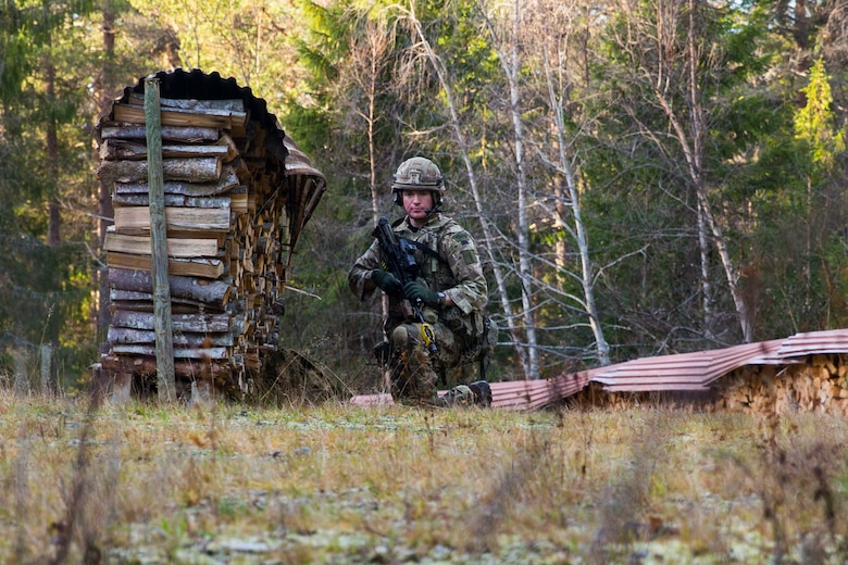 A British Royal Marine provides security while searching for a simulated isolated service member during a Tactical Recovery of Aircraft and Personnel (TRAP) exercise in Rindal, Norway, Nov. 6, 2018. The Royal Marines with X-Ray Company, 45 Commando, worked in conjunction with the 24th Marine Expeditionary Unit and assets from Marine Aircraft Group 29 to exercise their TRAP proficiency and bilateral interoperability during Exercise Trident Juncture 18. The exercise enhances the U.S. and NATO Allies' and partners' abilities to work together collectively to conduct military operations under challenging conditions. (U.S. Marine Corps photo by Cpl. Margaret Gale)