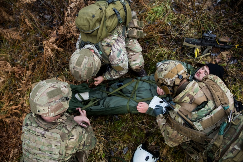 British Royal Marines prepare to evacuate Capt. Josef Otmar during a Tactical Recovery of Aircraft and Personnel (TRAP) exercise in Rindal, Norway, Nov. 6, 2018. The Royal Marines with X-Ray Company, 45 Commando, worked in conjunction with the 24th Marine Expeditionary Unit and assets from Marine Aircraft Group 29 to exercise their TRAP proficiency and bilateral interoperability during Exercise Trident Juncture 18. Otmar is a pilot with Marine Heavy Helicopter Squadron 366 and was playing the role of an isolated and injured service member. The exercise enhances the U.S. and NATO Allies' and partners' abilities to work together collectively to conduct military operations under challenging conditions. (U.S. Marine Corps photo by Cpl. Margaret Gale)