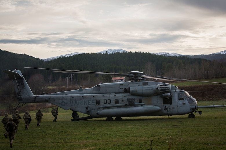A U.S. Marine Corps CH-53E Super Stallion lifts off from Rindal, Norway, during a Tactical Recovery of Aircraft and Personnel (TRAP) exercise, Nov. 6, 2018. The Royal Marines with X-Ray Company, 45 Commando, worked in conjunction with the 24th Marine Expeditionary Unit and assets from Marine Aircraft Group 29 to exercise their TRAP proficiency and bilateral interoperability during Exercise Trident Juncture 18. The exercise enhances the U.S. and NATO Allies' and partners' abilities to work together collectively to conduct military operations under challenging conditions. The aircraft is with Marine Heavy Helicopter Squadron 366, MAG-29. (U.S. Marine Corps photo by Cpl. Margaret Gale)