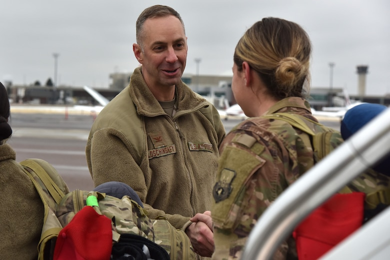 Col. Jason Loschinskey, 819th Rapid Engineer Deployable Heavy Operational Repair Squadron Engineers (RED HORSE) commander, greets Airmen as they return from deployment Nov. 5, 2018, at Great Falls International Airport, Mont. More than 150 RED HORSE Airmen returned from deployment between the last week of October and first week of November. (U.S. Air Force photo by Airman 1st Class Jacob M. Thompson)