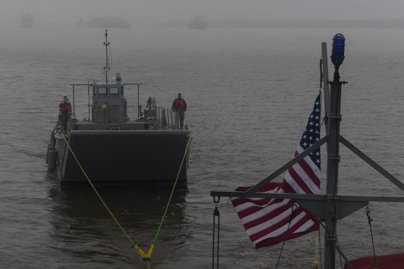 A Landing Craft Mechanized, Mark 8 is towed in the Chesapeake Bay during towing training at Joint Base Langley-Eustis, Virginia, Nov. 5, 2018. The Small Tug is capable of towing up to 37,000 pounds, which includes a variety in size of vessels to support the installation and brigade taskings. (U.S. Air Force photo by Senior Airman Derek Seifert)