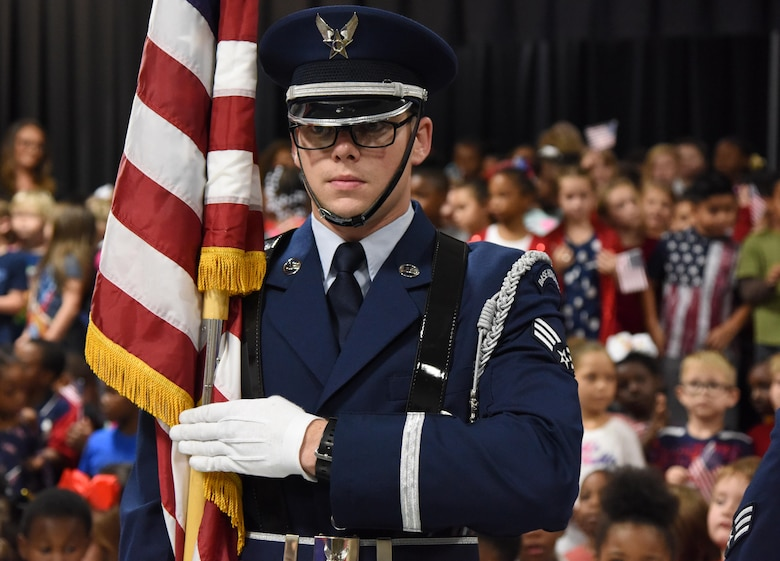 U.S. Air Force Senior Airman Fredrick Taylor, Keesler Honor Guard member, presents the colors during the Jeff Davis Elementary School Veterans Day celebration in Biloxi, Mississippi, Nov. 8, 2018. During the event, students recited the Pledge of Allegiance and sang several patriotic songs. Keesler Air Force Base leadership, honor guardsmen and base personnel attended the event. (U.S. Air Force photo by Kemberly Groue)