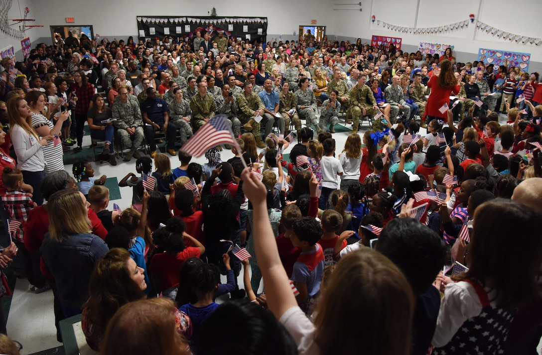 Keesler Air Force Base personnel and family members attend the Jeff Davis Elementary School Veterans Day celebration in Biloxi, Mississippi, Nov. 8, 2018. During the event, students recited the Pledge of Allegiance and sang several patriotic songs. Keesler Air Force Base leadership, honor guardsmen and base personnel attended the event. (U.S. Air Force photo by Kemberly Groue)