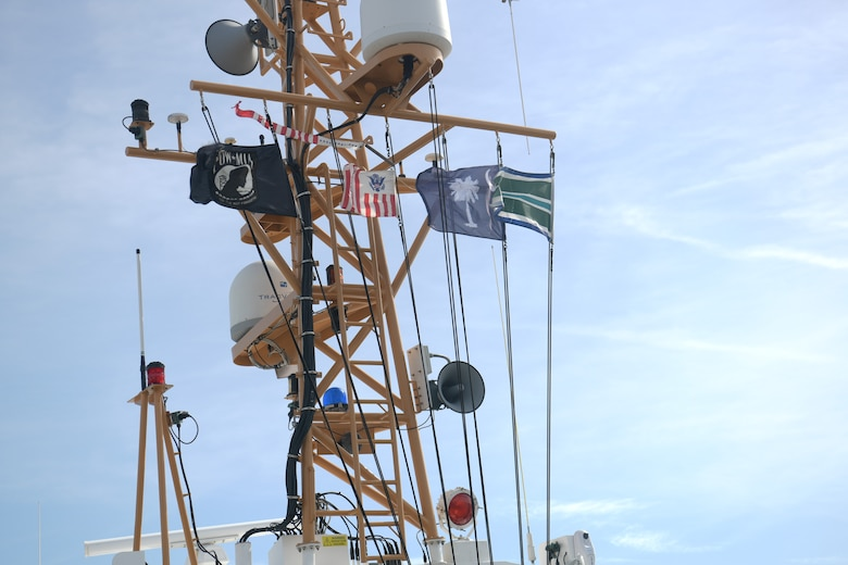 Flags blow in the wind atop the U.S. Coast Guard Cutter Cormorant Nov. 7, 2018 in Charleston, S.C. The ship's crew took the USCG Academy class of 1965 on a tour of the Charleston Harbor during the 50-year anniversary of when they deployed to Vietnam. The class was deployed to Vietnam in 1968 where they patrolled the coast of the country during the conflict.