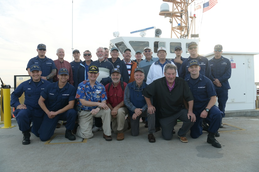 The crew of U.S. Coast Guard Cutter Cormorant and members of the U.S. Coast Guard Academy class of 1965, pose for a group photo Nov. 7, 2018, in Charleston, S.C. The ship's crew took the class of 1965 on a tour of the Charleston Harbor during the 50-year anniversary of when they deployed to Vietnam. The class was deployed to Vietnam in 1968 where they patrolled the coast of the country during the conflict.