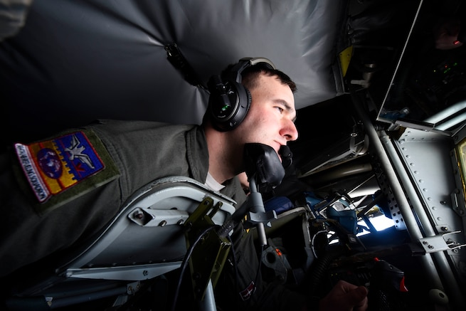 """U.S. Air Force Staff Sgt. Nick Lichtenwalner, 384th Air Refueling Squadron inflight refueling specialist, performs an inflight refueling mission in the U.S. Northwestern Region, Nov. 4, 2018. Inflight refueling specialists, commonly known as """"Boom Operators,"""" perform inflight operational checks of air refueling systems, direct receiver aircraft into air refueling position, and operate inflight controls and switches to initiate contact between tanker and receiver aircraft. (U.S. Air Force photo/Airman 1st Class Lawrence Sena)"""