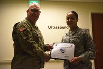 Seana McCants, diagnostic imaging technologist, is recognized as the Arctic Warrior of the Week at Joint Base Elmendorf-Richardson, Alaska, Nov. 9, 2018. The Arctic Warrior of the Week is an award highlighting JBER's top performing Airmen.