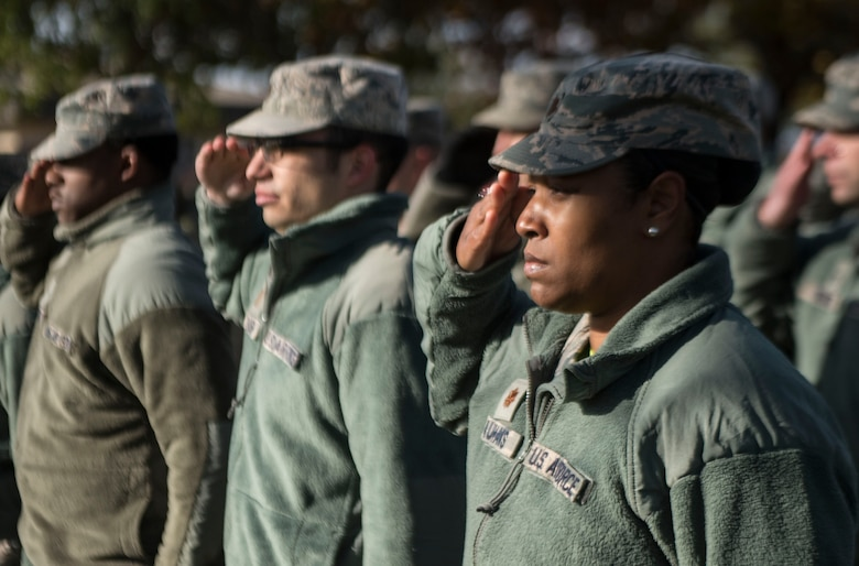 Maj. Marshalria Vaughans, commander of the 97th Communications Squadron, salutes during the playing of taps at a ceremony in honor of Staff Sgt. Andrew Bubacz, Nov. 11, 2018, Altus Air Force Base, Okla. The 97th CS has held a ceremony honoring Bubacz every year since 2010, who passed away in support of Operation Enduring Freedom.