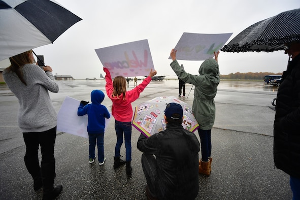 Families of Delaware Air National Guardsman watch as Airmen arrive home from deployment at New Castle Air National Guard Base, Del., Nov. 9, 2018. Over seventy percent of the Delaware ANG are part-time, traditional Guardsmen and deployed for their first time. (U.S. Air National Guard photo by Staff Sgt. John Michaels)