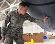 Senior Airman Taner Thomas, 931st Aircraft Maintenance Squadron  electrical and environmental journeyman, inspects a KC-135 Stratotanker static Nov. 3, 2018, McConnell Air Force Base, Kan. The Reserve Citizen Airman recently graduated McConnell's Airman Leadership School, and became the recipient of the John L. Levitow Award.