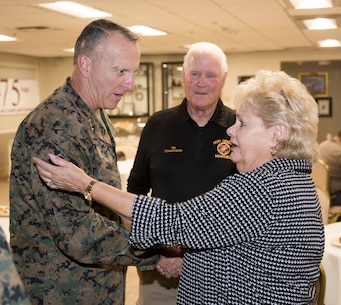 Lietenant General Charels G. Chiarotti, Deputy Commandant/Installations and Logistics, Headquarters Marine Corps, meets with Tim and Kathy Hille, of the High Desert Marines, during an evening social at the Major General James. L. Day Conference Center aboard MCLB Barstow Nov. 6.
