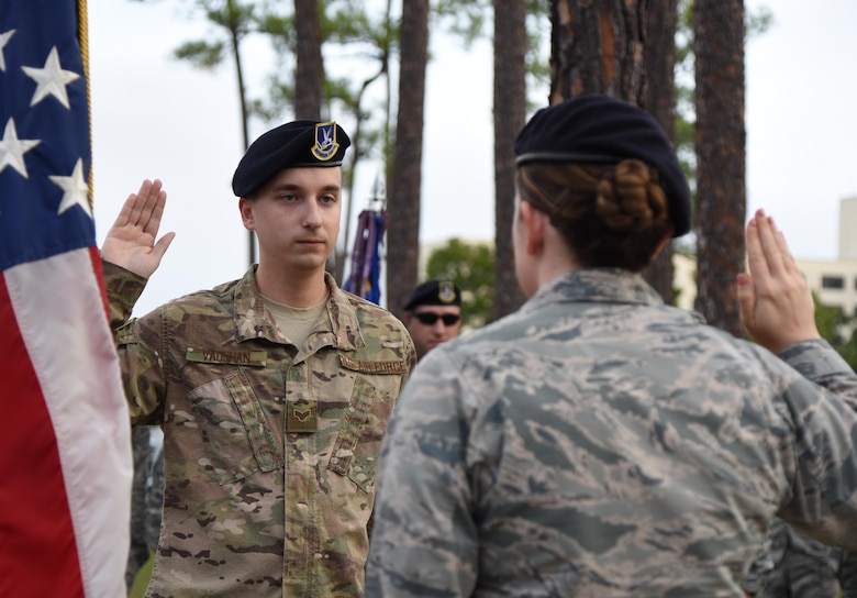U.S. Air Force Capt. Samantha Giebel, 81st Security Forces Squadron operations officer, delivers the oath of enlistment to Senior Airman James Vaughan IV, 81st SFS unit trainer, at Keesler Air Force Base, Mississippi, Nov. 9, 2018. Vaughan reenilisted prior to the 81st SFS Veterans Day Ruck March, which was held in honor of all veterans and victims of war. (U.S. Air Force photo by Kemberly Groue)